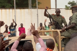 Malian soldiers celebrate as they arrive at the Independence Square in Bamako [Malik Konate/AFP]
