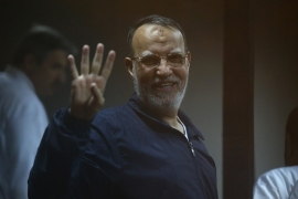 Egyptian Muslim Brotherhood senior member Essam el-Erian stands inside the defendant's cage during his trial at the police academy in Cairo [File: Ahmed Ramadan/AFP]