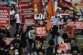 Hundreds of protesters in the Philippine capital march against the new anti-terror law, 27 July 2020, Manila, Philippines (AP Photo/Aaron Favila)
