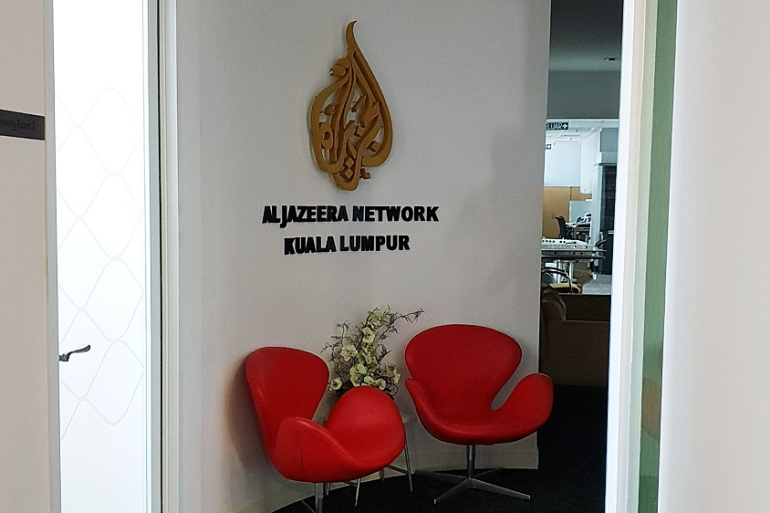 Malaysian officials on Tuesday searched the Qatar-based broadcaster's Kuala Lumpur office and seized two computers [File: Al Jazeera]
