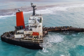 This aerial picture shows the MV Wakashio bulk carrier that had run aground and broke into two parts near Blue Bay Marine Park, Mauritius [AFP]