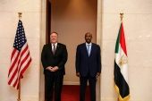 US Secretary of State Mike Pompeo (L) with Sudan's Sovereign Council chief General Abdel Fattah al-Burhan in this August 25, 2020 photo [File: Sudan's Foreign Media Council/AFP]