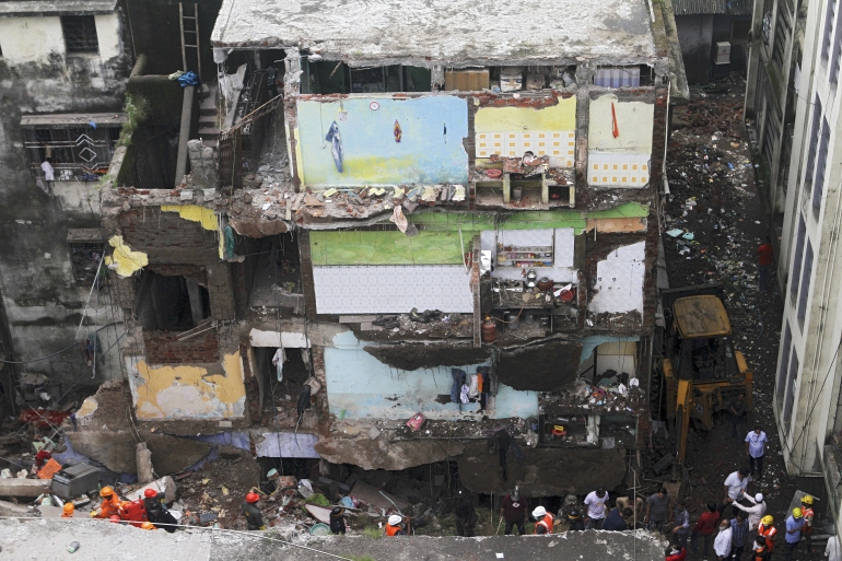 Rescue operations, aided by sniffer dogs, have been continuing with the help of the NDRF, but have been hampered by rain and a narrow entrance to the alley [AFP]