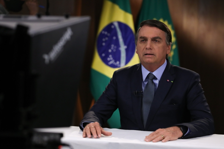 Jair Bolsonaro launched his charm offensive as Brazilian markets wobbled for a second day on fears the spending spree shows he is unwilling to rein in record deficits and debt [File: Marcos Correa/Brazilian Presidency/AFP Photo]