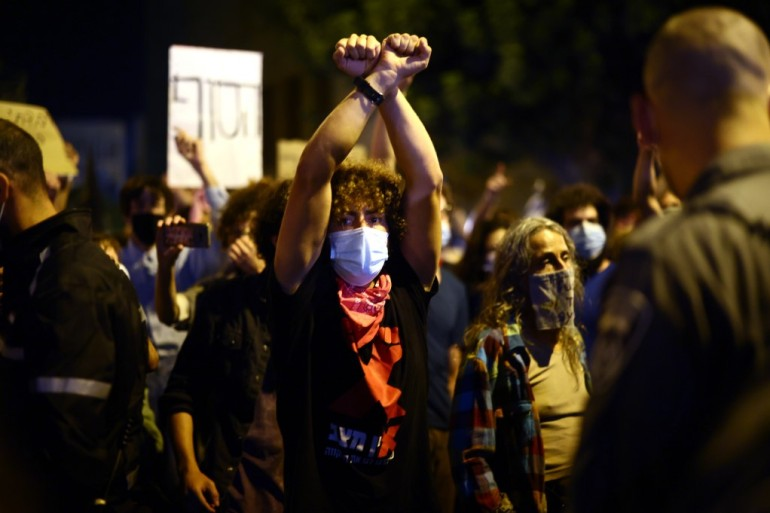 Organisers say around 16,000 joined the anti-Netanyahu demonstrations on Saturday [Emmanuel Dunand/AFP]