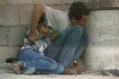 Footage taken by Talal Abu Rahma shows Jamal al-Durrah trying to protect his son, Muhammad, on September 30, 2000 in Gaza [Photo by France 2/AFP]