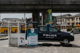 A police vehicle is seen during a nationwide curfew imposed as part of precautions against COVID-19 in Lagos in April [Anadolu/Vanessa Ade]
