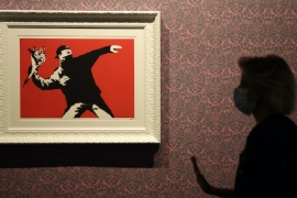Examiners for the cancellation division of the EU's Intellectual Property office noted in their ruling that Banksy's anonymity and contempt for copyrights worked against him in the case [File: Alessandra Tarantino/The Associated Press]