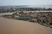 An aerial view shows buildings and roads submerged by floodwaters near the Nile river in South Khartoum, Sudan [El Tayeb Siddig/Reuters]