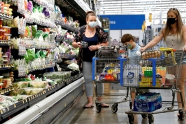 Consumers are seen wearing masks while shopping at a Walmart store in Bradford, Pennsylvania in July [File: Brendan McDermid/Reuters]