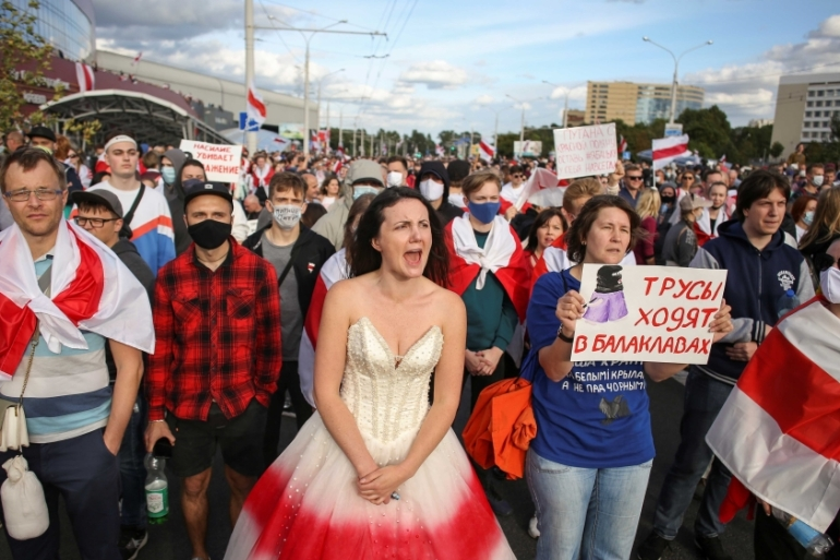 Opposition supporters take part in a rally against police brutality following protests in Minsk to reject the presidential election results on September 13, 2020 [Tut.By via Reuters]