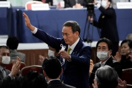 Yoshihide Suga won 377 of a total of 534 votes in the internal LDP election [Eugene Hoshiko/AFP]
