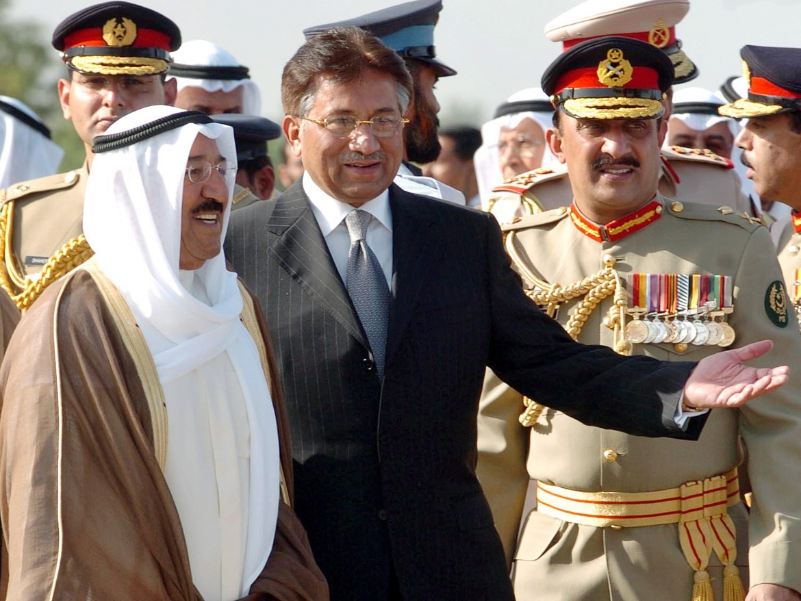 Former Pakistani President Pervez Musharraf, centre, escorts the Kuwaiti emir upon his arrival at a military base in Rawalpindi on June 19, 2006. [Mian Khursheed/Reuters]