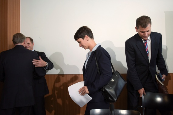 Frauke Petry, ex-chairwoman of the anti-immigration party Alternative for Germany (AfD), and former AfD spokesman Christian Lueth, right, leave a news conference in Berlin, Germany, September 5, 2016 File: Stefanie Loos/Reuters]