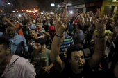 Small groups of protesters gather in central Cairo shouting anti-government slogans on September 21 [Mohamed Abd el-Ghany/Reuters]