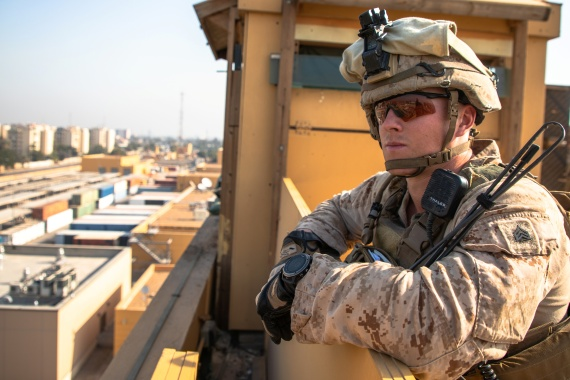 A US marine supervises his squad as they provide watch security at the US embassy compound in Baghdad, Iraq [File: Kyle C Talbot via Reuters]