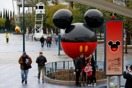California-based Disneyland, nicknamed the 'Happiest Place on Earth', and the company's other theme parks around the world have been forced to limit visitor numbers to allow for physical distancing [File: Mario Anzuoni/Reuters]