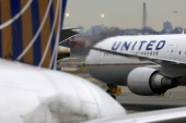 The Air Line Pilots Association said the deal will allow United to spread a reduced amount of flying across the airline's 13,000 pilots to save jobs at least until next June [File: Chris Helgren/Reuters]