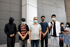 Pro-democracy activists Eddie Chu and Owen Chow with relatives of some of the 12 Hong Kong detainees report to the police in Hong Kong to seek help for them in China [Tyrone Siu/ Reuters]