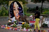 A woman visits the memorial for Breonna Taylor in Louisville, Kentucky, US [File: Bryan Woolston/Reuters]