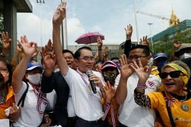 A group of royalists gesture as they show support to the monarchy, during their march in Bangkok [Soe Zeya Tun/Reuters]