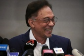 Malaysia's opposition leader Anwar Ibrahim says he has enough support from MPs to form a government [Lim Huey Teng/Reuters] (Reuters)