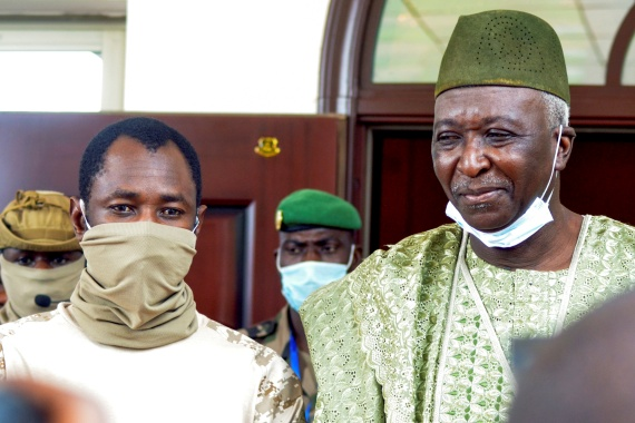 The new interim president of Mali, former colonel Bah Ndaw, right, is pictured with Colonel Assimi Goita, leader of the Malian military government in Bamako, Mali [Amadou Keita/Reuters]