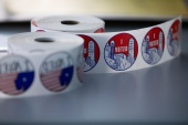 'I Voted' stickers for people who cast their ballots for the upcoming presidential elections are seen as early voting begins in Ann Arbor, Michigan, on September 24, 2020 [Emily Elconin/Reuters]