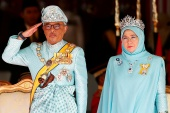 Malaysia's King Sultan Abdullah Sultan Ahmad Shah and Queen Tunku Azizah Aminah Maimunah attend a welcoming ceremony at Parliament House in Kuala Lumpur, Malaysia, on January 31, 2019 [File: Lai Seng Sin/ Reuters]
