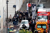General view as police officers investigate the scene of an incident near the former offices of French magazine Charlie Hebdo, in Paris, France September 25, 2020 [Gonzalo Fuentes/Reuters]