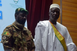 The new interim president of Mali, Bah Ndaw, right, attends the Inauguration ceremony with Mali's new Vice President Colonel Assimi Goita [Amadou Keita/Reuters]