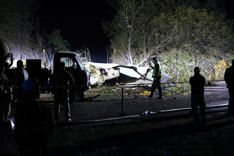 Rescuers inspect the wreckage of the Ukrainian military Antonov An-26 plane [Vyacheslav Madiyevskyy/Reuters]