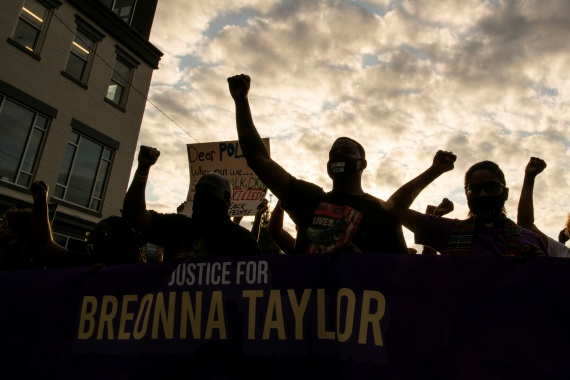 Demonstrators have marched in Louisville since a grand jury declined bring homicide charges against police officers involved in the fatal shooting of Breonna Taylor [Eduardo Munoz/Reuters]