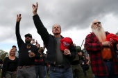 As of noon, several hundred members of the loosely affiliated Proud Boys group had gathered in Delta Park in Portland [Leah Millis/Reuters]