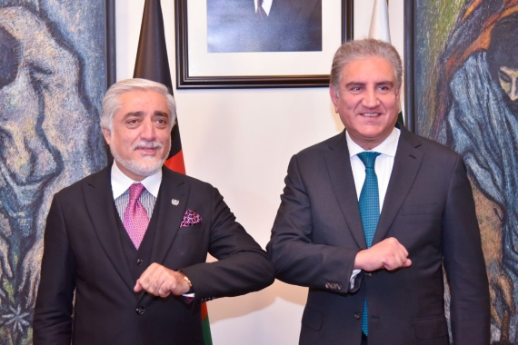 Pakistan's Foreign Minister Shah Mahmood Qureshi bumps elbows with the head of the Afghanistan's peace council, Abdullah Abdullah in Islamabad [Pakistan Ministry of Foreign Affairs/Reuters]