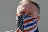 US Secretary of State Mike Pompeo wears a protective face mask as he visits the Naval Support Activity base at Souda, Crete, Greece September 29, 2020 [Aris Messinis/Reuters]