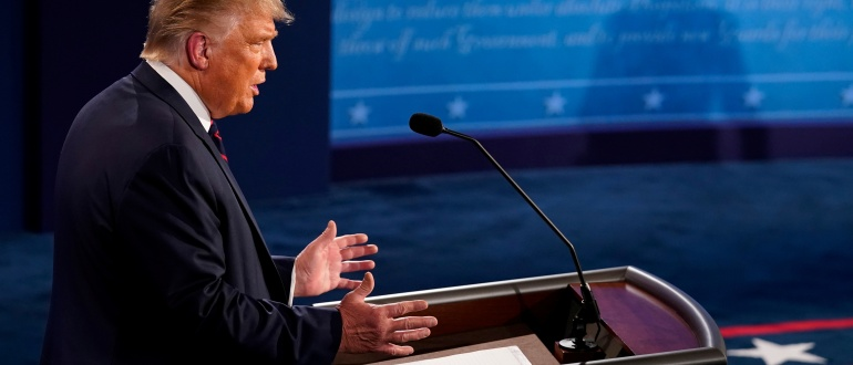 U.S. President Donald Trump participates in the first 2020 presidential campaign debate with Democratic presidential nominee Joe Biden (not pictured), held on the campus of the Cleveland Clinic at Case Western Reserve University in Cleveland, Ohio, U.S., September 29, 2020. Morry Gash/Pool via REUTERS