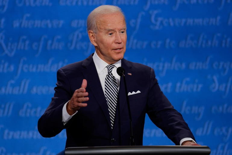 Democratic presidential nominee Joe Biden gestures as he participates in the first 2020 presidential campaign debate with US President Donald Trump on Tuesday [Brian Snyder/Reuters]