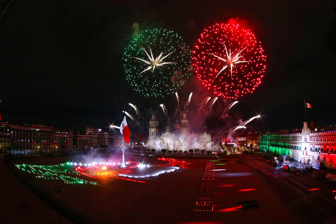 Fireworks explode over the Zocalo square during the ceremony of the Cry of Dolores, at the National Palace in Mexico City. Lopez Obrador celebrated an unprecedented Cry of Dolores, the battle cry of the 1810 Mexican War of Independence, in an environment marred by the coronavirus pandemic. [Jose Pazos/EPA]