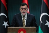 "Fayez al-Sarraj welcomed political dialogue with all factions and regions of Libya, except those who have ""spilled Libyan blood' [File: Turkish Presidency via AP]"