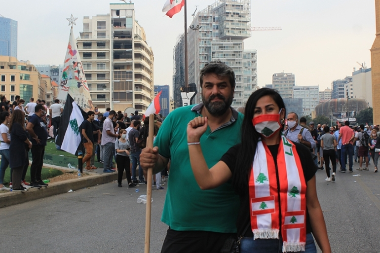 A couple takes part in anti-government protests calling on the ruling elite to hold those responsible for the Beirut blast accountable [Arwa Ibrahim/Al Jazeera]