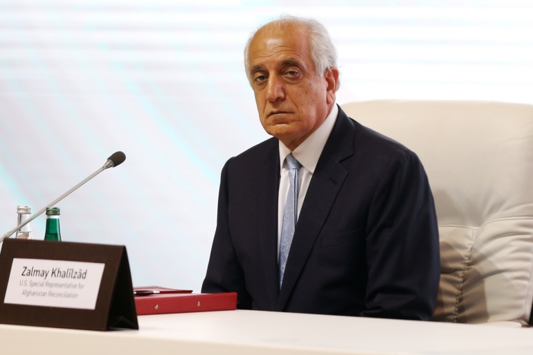 Zalmay Khalilzad, US envoy for peace in Afghanistan, is seen during talks between the Afghan government and the Taliban in Doha, Qatar, September 12, 2020 [File: Ibraheem al Omari/Reuters]