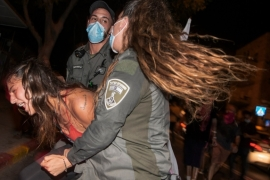 Demonstrators have been protesting Prime Minister Benjamin Netanyahu's handling of the coronavirus crisis, which has led to soaring unemployment, and they say he should step down while on trial for corruption charges [Ariel Schalit/AP]