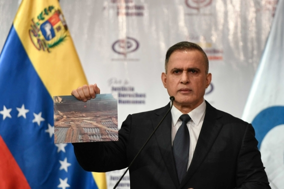 Venezuela's Attorney General Tarek William Saab holding a photo of bullets he says were seized with other weapons in connection with what the government calls a failed attack during the weekend aimed at overthrowing President Nicolas Maduro [File: AP Photo/Matias Delacroix]