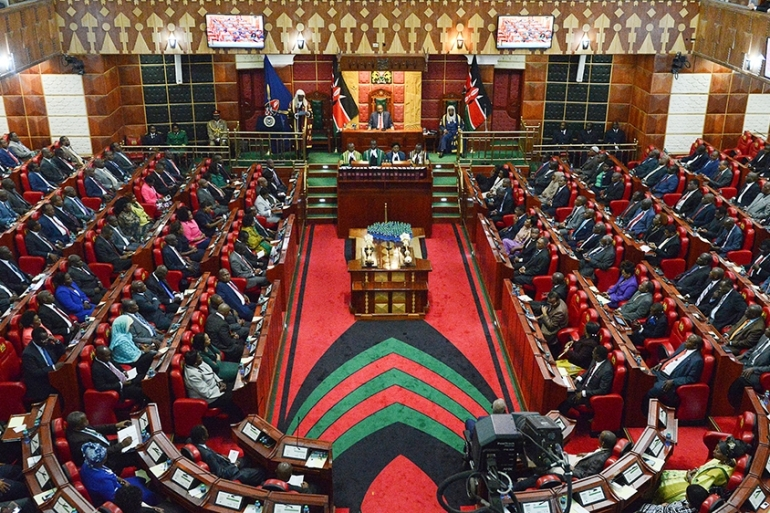 Women hold 22 percent of seats in the country's lower house of Parliament and 31 percent in the upper house [Simon Maina/AFP]