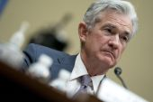 United States Federal Reserve Chair Jerome Powell has nudged Congress, saying more fiscal support would likely be necessary to keep recovery on track, but other Fed officials have been more direct with their pleas to US lawmakers [File: Stefani Reynolds/Bloomberg]