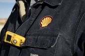 Oil-and-gas giant Royal Dutch Shell is retooling its business to prepare for a low-carbon future, but the transition is expected to involve large cost-cutting measures [File: Matthew Busch/Bloomberg]