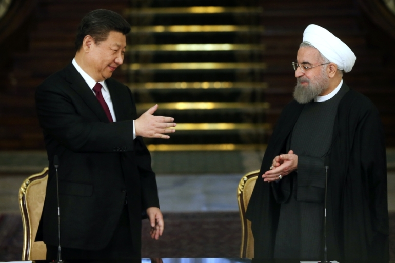 China's President Xi Jinping, left, and his Iranian counterpart Hassan Rouhani are seen together following a joint press conference in Tehran, Iran, January 23, 2016 [AP Photo/Ebrahim Noroozi]