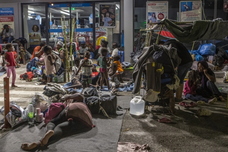 Asylum seekers previously living in the Moria camp on Lesbos are now sleeping rough in front of a Greek supermarket in improvised shelters [Anna Pantelia/Al Jazeera]