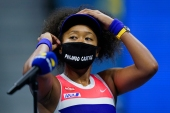 Japan's Naomi Osaka wore seven masks for each of her US Open matches to honour Black victims of violence [Seth Wenig/AP Photo]